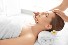 Young woman enjoying of facial massage. In spa salon stock images