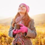 Young woman enjoying the fall season. Autumn outdoor portrait Royalty Free Stock Photos