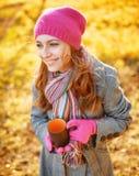Young woman enjoying the fall season. Autumn outdoor portrait Stock Photo