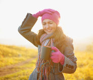 Young woman enjoying the fall season. Autumn outdoor portrait Stock Photography