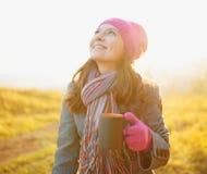 Young woman enjoying the fall season. Autumn outdoor portrait Stock Photos