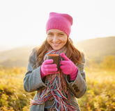 Young woman enjoying the fall season. Autumn outdoor portrait Stock Images