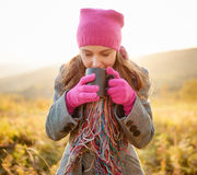 Young woman enjoying the fall season. Autumn outdoor portrait Royalty Free Stock Photography