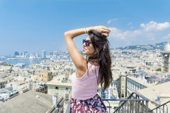 Young woman enjoying the freedom with open arms at  balcony over the city of Genova Royalty Free Stock Photo