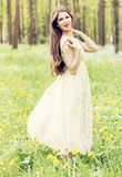 Young woman enjoying the fresh air in green forest. Royalty Free Stock Photo