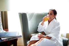 Young woman enjoying a glass of fresh orange juice Stock Photos