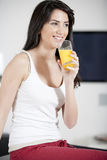 Young woman enjoying a glass of juice Royalty Free Stock Photos