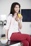 Young woman enjoying a glass of juice Stock Photo