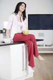 Young woman enjoying a glass of juice Stock Photos