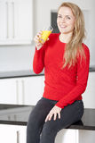 Young woman enjoying a glass of juice Royalty Free Stock Photography