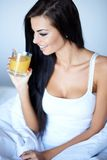 Young woman enjoying a glass of orange juice Stock Photos