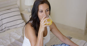 Young woman enjoying a glass of orange juice Royalty Free Stock Image