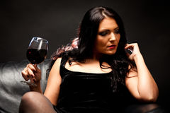Young Woman Enjoying A Glass Of Wine Stock Photos