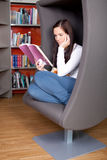 Young woman enjoying a good book Stock Photo