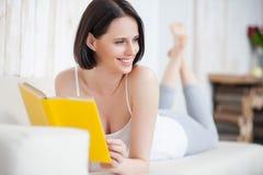 Young woman enjoying good book Stock Photos