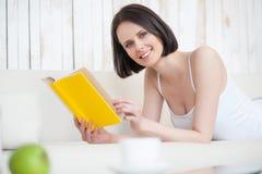 Young woman enjoying good book Royalty Free Stock Photo