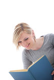 Young woman enjoying her book Stock Image