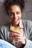 Young woman enjoying her fruit juice drink Royalty Free Stock Images