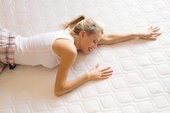 Woman enjoying her new comfortable mattress. Young woman enjoying her new comfortable mattress royalty free stock photo