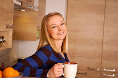 Happy tea time. Young woman enjoying her tea break Royalty Free Stock Photography