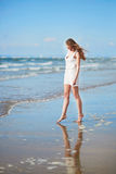 Young woman enjoying her vacation by sea Royalty Free Stock Photo