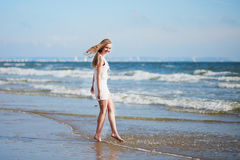 Young woman enjoying her vacation by sea Stock Photography