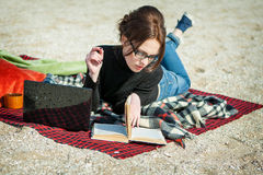 Young woman enjoying her working on the beach Stock Photography