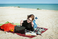Young woman enjoying her working on the beach Royalty Free Stock Image