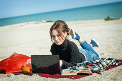 Young woman enjoying her working on the beach Royalty Free Stock Photography