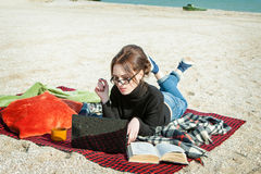 Young woman enjoying her working on the beach Royalty Free Stock Photo