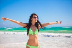 Young woman enjoying the holiday spread her hands Stock Photography