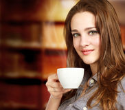 Young Woman Enjoying a Hot Beverage Royalty Free Stock Photography