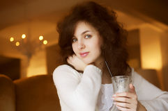 Young woman enjoying latte coffee in cafe Royalty Free Stock Photography