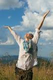Young woman enjoying life on a mountain meadow Stock Image