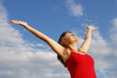 Young woman enjoying life outside. Young woman enjoying life outddors with hands to blue sky Royalty Free Stock Photo