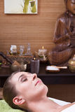 Young woman enjoying massage in salon Royalty Free Stock Photography