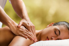 Young woman enjoying massage in spa. royalty free stock images
