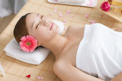 A young woman enjoying massage at spa. Indoors Stock Photos