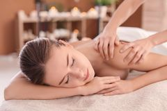 Young woman enjoying massage. In spa salon Stock Images