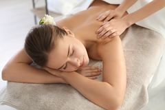 Young woman enjoying massage. In spa salon Stock Photography