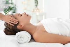 Young woman enjoying massage. In spa salon Royalty Free Stock Photos