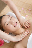 A young woman enjoying massage at spa. A young women enjoying massage at spa, indoors Royalty Free Stock Photo