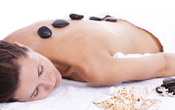 Young woman enjoying massage therapy Royalty Free Stock Image