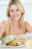 Young Woman Enjoying Meal Royalty Free Stock Photography
