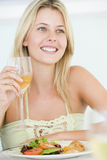 Young Woman Enjoying Meal Stock Image