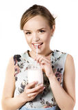 Young woman enjoying a  milk cocktail  Royalty Free Stock Images