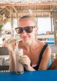 Young woman enjoying milkshake Stock Photo
