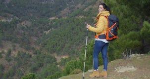 Young woman enjoying a mountain hike stock footage