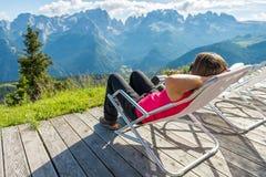 Young woman enjoying mountain view. Brenta group above Madonna di Campiglio Royalty Free Stock Photos