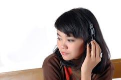 Young  woman enjoying the music Stock Photo